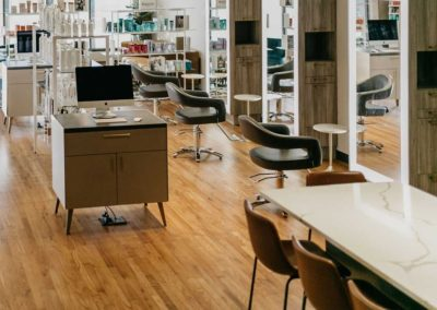 Hair Salon With Countertop Workstations And Large Group Table